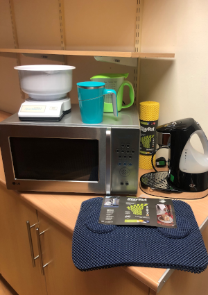 A picture of various kitchen gadgets, including talking kitchen scales and talking microwave